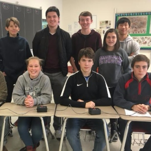 History Bowl members seated at desk