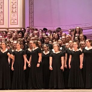 Concert chorale on stage at Carnegie Hall