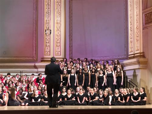 Students sing at Carnegie Stage