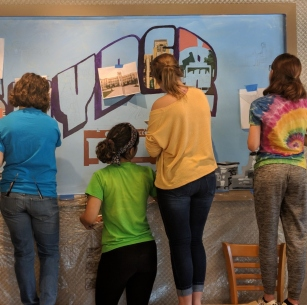 Art students paint Snyder mural at Spot Coffee