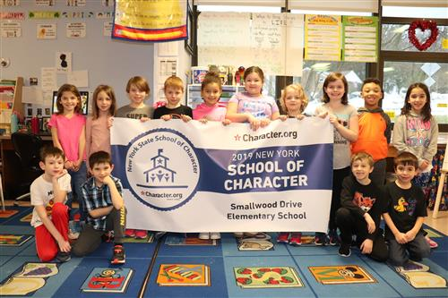 Children hold School of Character banner