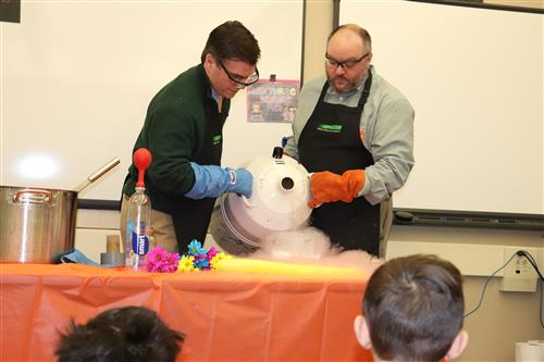 Praxair scientists pour liquid nitrogen