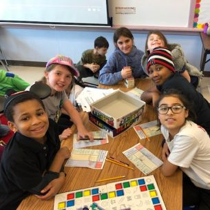 Students play board games
