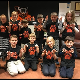 Elementary students dressed in shirts with tiger paws