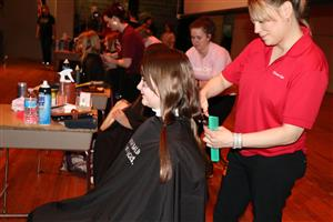 Students gets hair cut