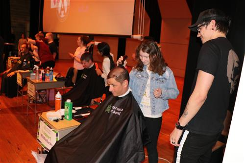 Teachers getting hair shaved by students