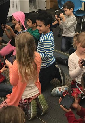 Kindergarten students in library with Google Expedition goggles