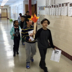 Students carry Olympic torch