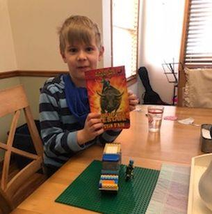 Boy holds book