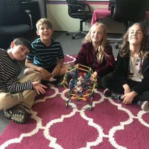 Students with KNex amusement park ride