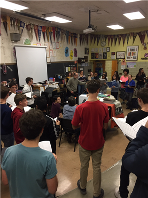 Camerata di Sant' Antonio Chamber Orchestra conductor Christopher Weber works with ACHS students