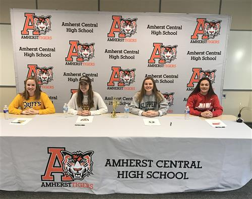 Four students sign NLI