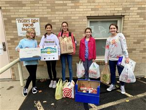 JV Tennis 2019 Collects Donations