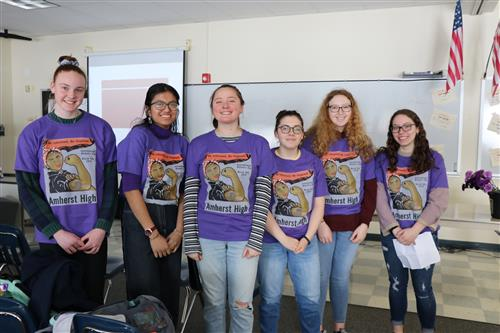 Students organizers in commemorative shirts