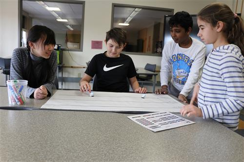 Four students work in group