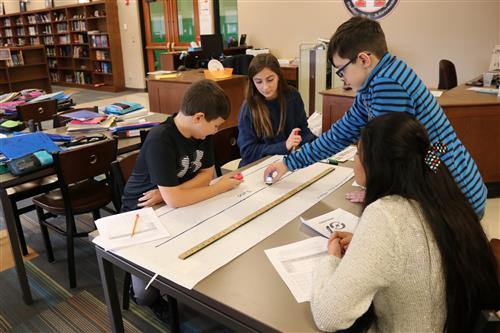 Team of students draw meter-long lines