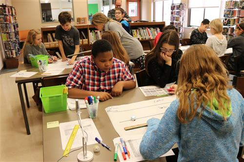 Students work in library on project