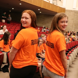 Two girls show back of Trailblazers T-shirts