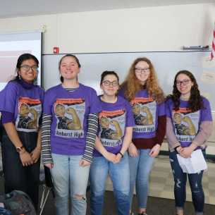 Female students wear commemorative t-shirts