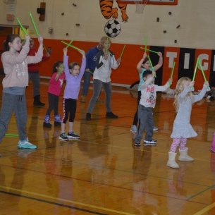 Families exercise at wellness fair