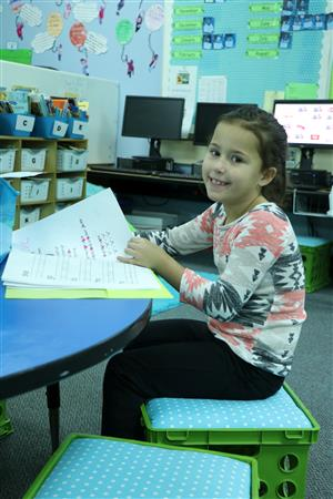 First grader uses chair cushions